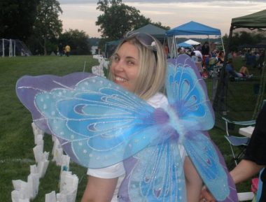 photo of me from behind, looking back over butterfly wings