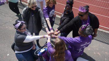 Photo shows 7 sarcoidosis warriors in a circle, with fists together in the middle